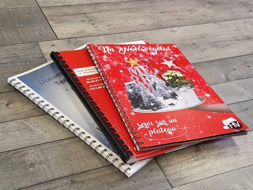 Impact communication impression documents reliés, brochures et catalogues en Normandie