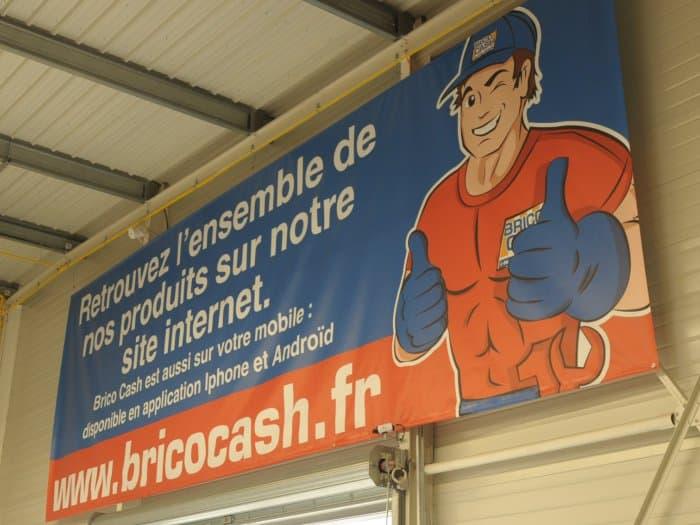 impact communication réalisation de bâches et de banderoles pour Bricocash à Saint-Marcel (27)